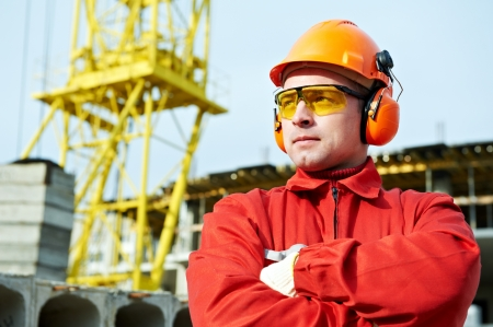 protective goggles: builder worker at construction site Stock Photo