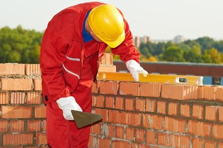 paredes de ladrillos: construcción albañil albañil trabajador Foto de archivo