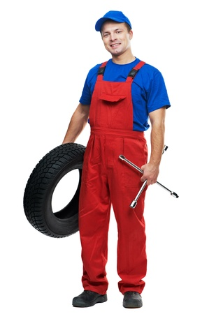 car mechanic: automobile mechanic with car tire and spanner
