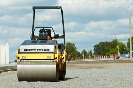 compactor roller at road work photo