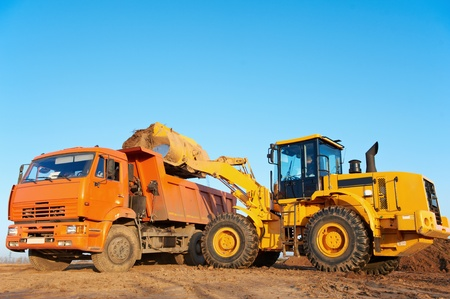 bulldozers: wheel loader excavator and tipper dumper Stock Photo