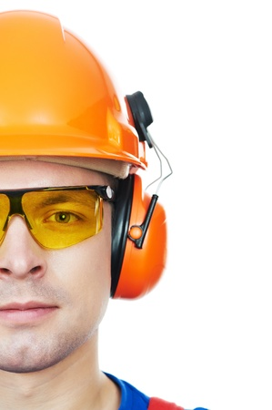 safety glasses: builder in hard hat, earmuffs and goggles