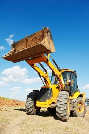 Excavator Loader with backhoe works photo
