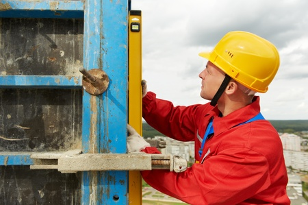 formwork: builder with level Stock Photo