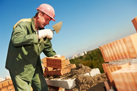 sand lime bricks: construction mason worker bricklayer Stock Photo