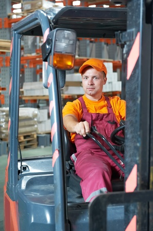 warehouse worker driver in forklift photo