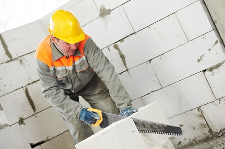 cement solution: construction mason worker bricklayer Stock Photo