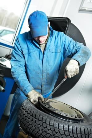 machanic repairman at tyre fitting Stock Photo - 11305116