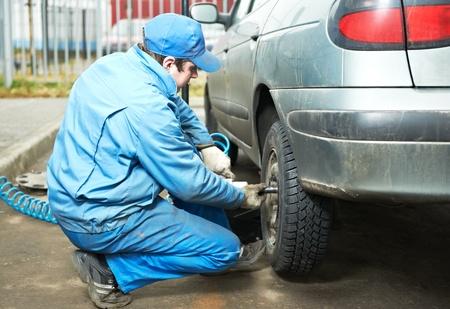 machanic repairman at tyre fitting Stock Photo - 11305129