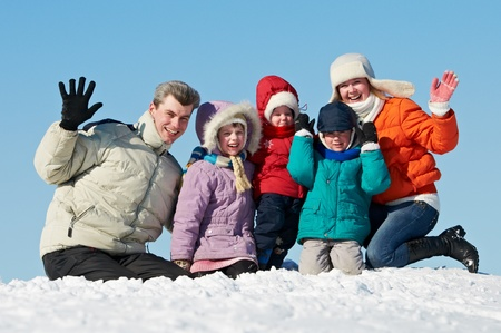 happy family with children in winter photo