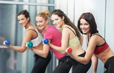 skinny woman: healthy woman doing fitness exercise with dumbbell