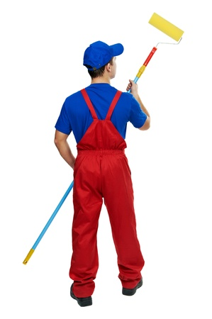 pintor de casas: pintor, el hombre de uniforme, con rodillo de pintura Foto de archivo