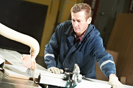 toolroom: worker at workshop with circ saw