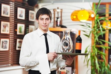 waiter tray: waiter in uniform at restaurant Stock Photo