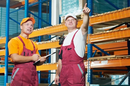 manual workers in warehouse photo