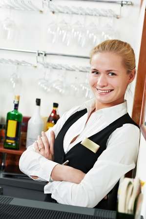 barman: restaurant manager bartender woman at work place