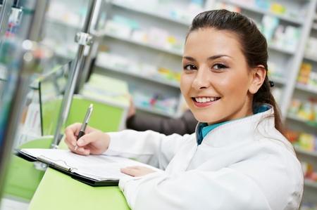 pharmacy: Pharmacy chemist woman in drugstore Stock Photo