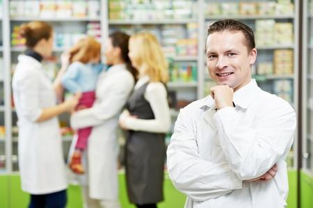 pharmaceutic: Confident pharmacy chemist man in drugstore