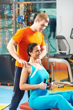 simulator: woman with trainer at training simulator