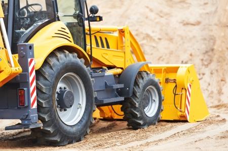 maquinaria pesada: Excavadoras Cargadoras con obras retroexcavadora Foto de archivo