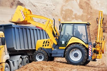 backhoe loader: wheel loader excavator and tipper dumper Stock Photo