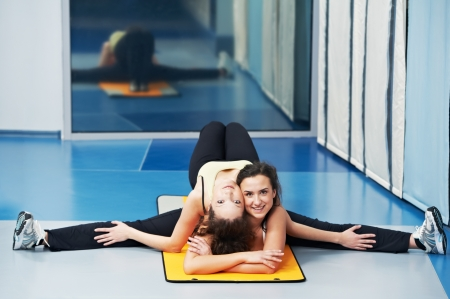 women doing exercise stretching at fitness club photo