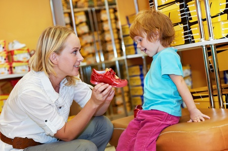 purchaser: woman and child girl making shopping