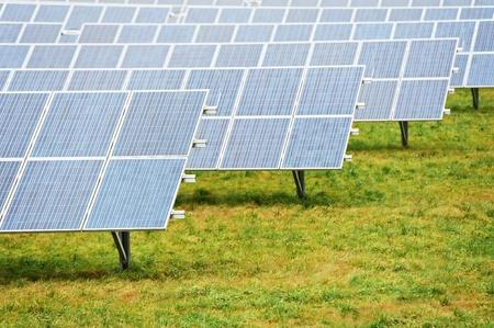 solar array: Ecology energy farm with solar panel battery field Stock Photo