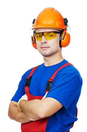 mounter: Portrait of young builder in protective safety equipment goggles hard hat earmuffs isolated