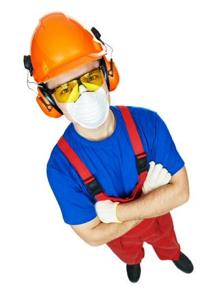 earmuffs: Portrait of young builder in protective safety equipment goggles hard hat earmuffs and respirator gas mask isolated Stock Photo