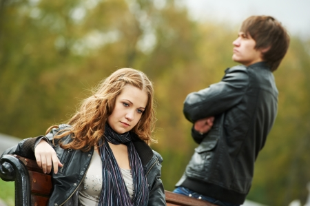 emotional stress: conflict and emotional stress in young people couple relationship outdoors