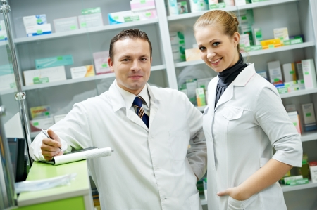 cheerful pharmacist chemist woman standing in pharmacy drugstore Stock Photo - 21735492