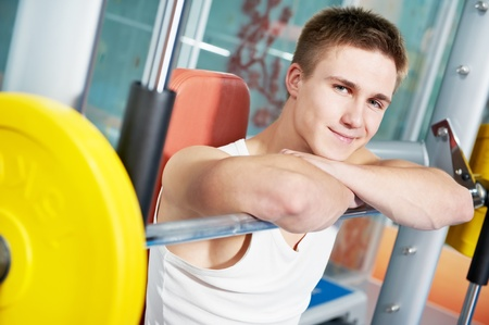 bodybuilder man doing muscle exercises with weight Stock Photo - 12283491