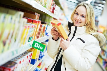 woman making dairy shopping Stock Photo - 12283495