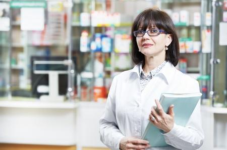 Pharmacy chemist woman in drugstore Stock Photo - 12283502