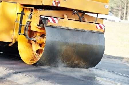 construction vibroroller: compactor roller at asphalting work