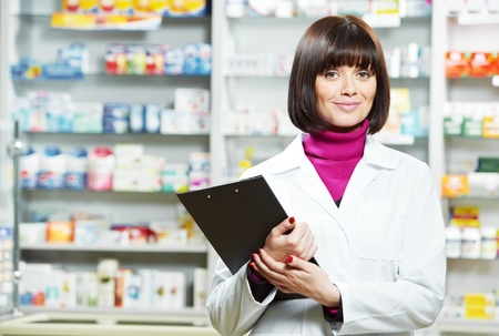 pharmacist: Pharmacy chemist woman in drugstore Stock Photo