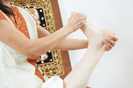 Traditional thai massage health care foot kneading photo
