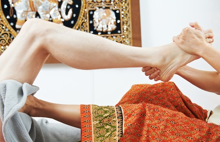 traditional wellness: Traditional thai massage health care foot kneading