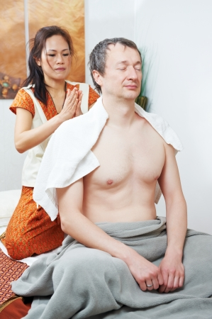 Traditional thai massage health care back kneading photo