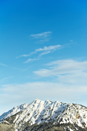 Snow covered beautiful alpine mountain peaks photo