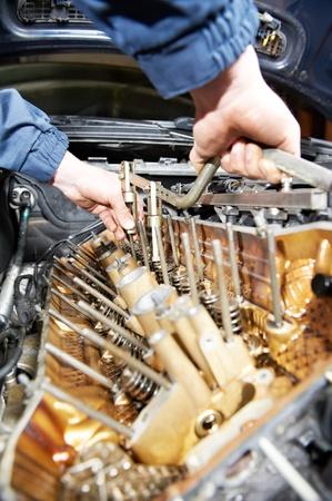 servicing: machanic repairman at automobile car engine repair Stock Photo