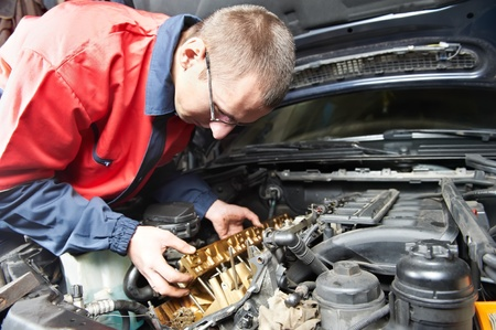mechanician: machanic repairman at automobile car engine repair Stock Photo