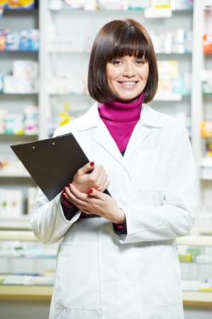 Pharmacy chemist woman in drugstore Stock Photo - 12283498