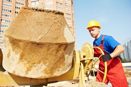 obrero: constructor de los trabajadores en el sitio de la construcción Foto de archivo