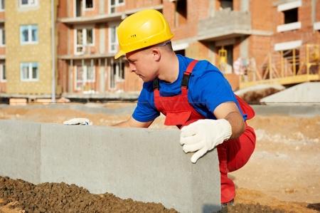 kerb: builder installing road concrete kerb Stock Photo