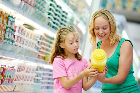 groceries shopping: woman and girl making shopping Stock Photo