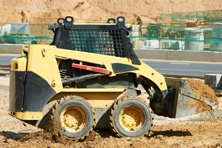 skid steer loader at earth moving works Stock Photo - 12605618