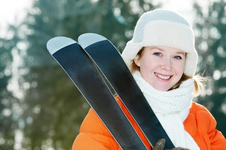 girl at winter clothing with skis photo
