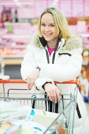 woman making dairy shopping Stock Photo - 12589275